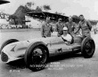 1949 winner Bill Holland sit in his Blue Crown Special with his crew after qualifying for the race. -- Photo by: No Photographer