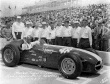 Marshall Teague and crew after qualifying the #48 Sumar Special (KK500C/Offy) for the 1957 Indianapolis 500. -- Photo by: No Photographer