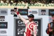Scott Dixon performs the traditional wine toast after winning the GoPro Grand Prix of Sonoma at Sonoma Raceway -- Photo by: Chris Jones
