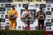 The podium of Scott Dixon, Ryan Hunter-Reay, & Simon Pagenaud with their trophies in Victory Lane at Sonoma Raceway -- Photo by: Chris Jones