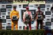 The podium of Scott Dixon, Ryan Hunter-Reay, and Simon Pagenaud with their trophies in Victory Lane at Sonoma Raceway -- Photo by: Chris Jones