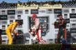 Scott Dixon, Ryan Hunter-Reay, and Simon Pagenaud spray the champagne in Victory Circle at Sonoma Raceway -- Photo by: Chris Jones