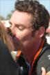 Simon Pagenaud gets a congratulatory kiss from his girlfriend following the GoPro Grand Prix of Sonoma at Sonoma Raceway -- Photo by: Richard Dowdy