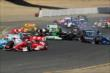 The field scatter as they avoid the cars of Sebastien Bourdais and Ryan Briscoe at Sonoma Raceway -- Photo by: Richard Dowdy