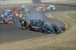 The cars of Ryan Briscoe and Sebastien Bourdais go off course during the start of the GoPro Grand Prix of Sonoma at Sonoma Raceway -- Photo by: Richard Dowdy