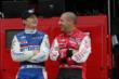 Ryan Briscoe and Tony Kanaan chat on pit lane prior to practice for the Iowa Corn Indy 300 at Iowa Speedway -- Photo by: Chris Jones