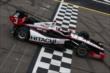 Helio Castroneves crosses the start/finish line during practice for the Iowa Corn Indy 300 at Iowa Speedway -- Photo by: Chris Jones