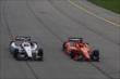 Helio Castroneves and Simon Pagenaud go side-by-side during practice for the Iowa Corn Indy 300 at Iowa Speedway -- Photo by: Chris Jones