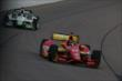 Teammates Sebastian Saavedra and Sebastien Bourdais enter Turn 1 during practice for the Iowa Corn Indy 300 at Iowa Speedway -- Photo by: Chris Jones