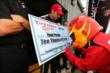 The Firestone Firehawk signs a check for Will Power winning the Pit Stop Performance Award for Pocono -- Photo by: Chris Jones