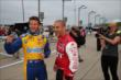 Marco Andretti and Tony Kanaan have a laugh prior to qualifications for the Iowa Corn Indy 300 at Iowa Speedway -- Photo by: Chris Jones