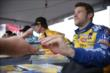 Marco Andretti signs some autographs in the INDYCAR Fan Village at Iowa Speedway -- Photo by: Shawn Gritzmacher