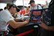 Graham Rahal signs autographs in the INDYCAR Fan Village at Iowa Speedway -- Photo by: Shawn Gritzmacher