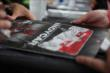 A fan collects autographs in the INDYCAR Fan Village at Iowa Speedway -- Photo by: Shawn Gritzmacher