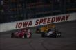 Scott Dixon, Will Power, and Ryan Hunter-Reay mix it up a bit during the Iowa Corn Indy 300 at Iowa Speedway -- Photo by: Chris Jones