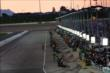 Pit lane comes to life during the early stages of the Iowa Corn Indy 300 at Iowa Speedway -- Photo by: Chris Jones