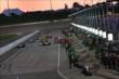 An active pit lane during early pit stops of the Iowa Corn Indy 300 -- Photo by: Chris Jones