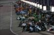 Crews get to work during the first round of pit stops of the Iowa Corn Indy 300 at Iowa Speedway -- Photo by: Chris Jones