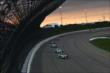 Sebastien Bourdais and Carlos Munoz lead a group of cars during the early stages of the Iowa Corn Indy 300 at Iowa Speedway -- Photo by: Chris Jones