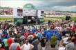 Fans surround the pre-race stage during driver introductions for the Iowa Corn Indy 300 at Iowa Speedway -- Photo by: Chris Jones