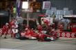 The Target Chip Ganassi Racing team of Scott Dixon go to work during an early pit stop during the Iowa Corn Indy 300 -- Photo by: Chris Jones