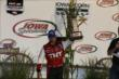 Tony Kanaan hoists his 3rd place trophy for the Iowa Corn Indy 300 at Iowa Speedway -- Photo by: Chris Jones