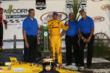 Ryan Hunter-Reay accepts his winners trophy in Victory Lane after winning the Iowa Corn Indy 300 at Iowa Speedway -- Photo by: Chris Jones