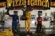 Ryan Hunter-Reay, Josef Newgarden, and Tony Kanaan raise their trophies on the podium at Iowa Speedway -- Photo by: Chris Jones