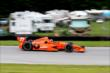 Simon Pagenaud makes his way into the Turn 10 Carousel during practice for the Honda Indy 200 at Mid-Ohio -- Photo by: Bret Kelley
