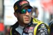 Tony Kanaan sits in his pit stand prior to practice for the Honda Indy 200 at Mid-Ohio -- Photo by: Chris Owens