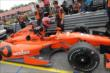 Simon Pagenaud slides into the cockpit prior to practice for the Honda Indy 200 at Mid-Ohio -- Photo by: Joe Skibinski