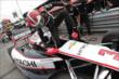 Helio Castroneves climbs into his machine prior to practice for the Honda Indy 200 at Mid-Ohio -- Photo by: Joe Skibinski