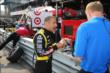 Tony Kanaan chats with the media on pit lane prior to practice for the Honda Indy 200 at Mid-Ohio -- Photo by: Bret Kelley