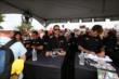 Team Penske teammates Juan Pablo Montoya, Helio Castroneves, and Will Power sign autographs in the INDYCAR Fan Village at Mid-Ohio -- Photo by: Chris Jones