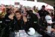 Andretti Autosport let the silly string fly at Will Power during the autograph session in the INDYCAR Fan Village at Mid-Ohio -- Photo by: Chris Jones