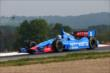 Ryan Briscoe navigates the Turn 2 Keyhole turn during practice for the Honda Indy 200 at Mid-Ohio -- Photo by: Chris Jones