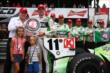 Sebastien Bourdais with the Verizon P1 Award after winning the pole for the Honda Indy 200 at Mid-Ohio -- Photo by: Chris Jones