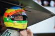 Mike Conway straps on his helmet prior to practice for the Honda Indy 200 at Mid-Ohio -- Photo by: Chris Owens