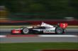 Helio Castroneves exits Turn 1 during  practice for the Honda Indy 200 at Mid-Ohio -- Photo by: Chris Owens