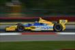 Marco Andretti exits Turn 1 during practice for the Honda Indy 200 at Mid-Ohio -- Photo by: Chris Owens