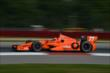 Simon Pagenaud exits Turn 1 during practice for the Honda Indy 200 at Mid-Ohio -- Photo by: Chris Owens