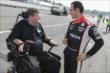 Helio Castroneves and Schmidt Peterson Motorsports team co-owner Sam Schmidt chat on the Mid-Ohio pit lane -- Photo by: Joe Skibinski