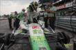 Sebastien Bourdais climbs into his machine prior to qualifications for the Honda Indy 200 at Mid-Ohio -- Photo by: Joe Skibinski