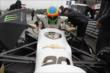 Mike Conway slides into his machine prior to qualifications for the Honda Indy 200 at Mid-Ohio -- Photo by: Joe Skibinski