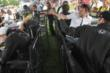Andretti Autosport let the silly string fly at Will Power during the autograph session in the INDYCAR Fan Village at Mid-Ohio -- Photo by: Joe Skibinski