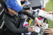 Charlie Kimball signs an autograph in the INDYCAR Fan Village at Mid-Ohio -- Photo by: Joe Skibinski