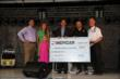 INDYCAR CMO C.J. O'Donnell and Michael Andretti present a donation to the Children's Hospital of Wisconsin and Racing For Kids -- Photo by: Chris Jones