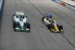 Teammates Carlos Munoz and Marco Andretti go side-by-side down the front stretch during practice for the ABC Supply Wisconsin 250 at the Milwaukee Mile -- Photo by: Chris Jones
