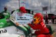 The Firestone Firehawk signs the check for Andretti Autosport and Carlos Munoz for their pit stop performance at Mid-Ohio -- Photo by: Chris Jones