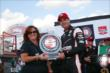 Will Power accepts the Verizon P1 Award for winning the pole position for the ABC Supply Wisconsin 250 from the Milwaukee Mile -- Photo by: Chris Jones